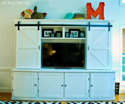 tv cabinet with sliding doors to hide tv as a thrifter awesome cabinet with sliding barn