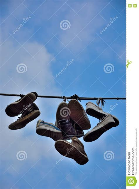 hanging photos on wire shoes hanging on wire royalty free stock image