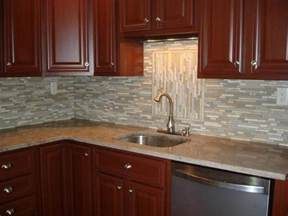 Kitchen Backsplash Glass Tile Ideas to accent the location of the sink the long lines of the backsplash