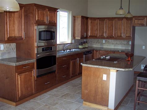gray countertops with brown cabinets building a home cabinets