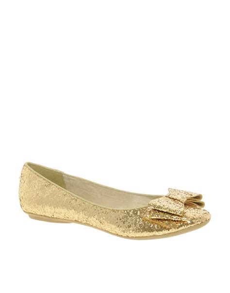 gold flat shoes for image 1 of faith azriel gold glitter bow flat shoes