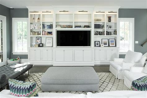 white living room tv cabinet nickel picture lights transitional living room