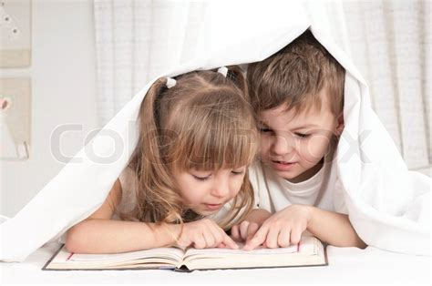 brother and sister in bed lovely children brother and sister reading a book on