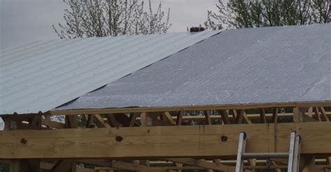 vapor barrier under house metal roof condensation barrier aurora roofing contractors