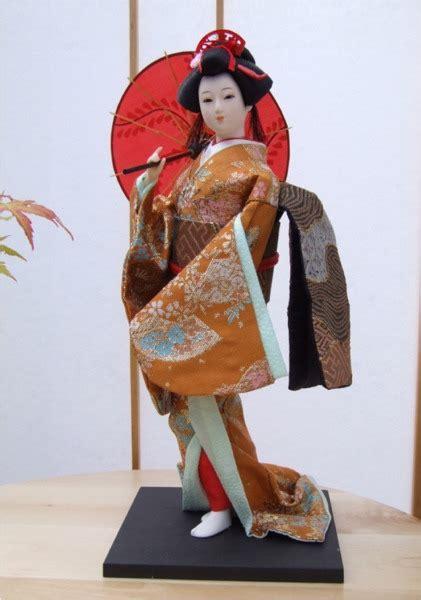 kimono doll design umbrella japanese geisha doll with gold coloured kimono holding an