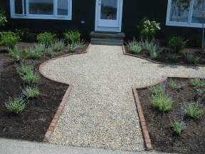 pea gravel walkway bordered with brick backyard patio