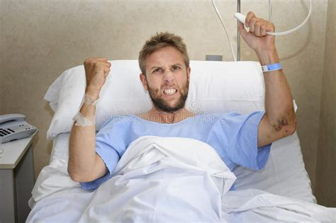 man in hospital bed angry patient man at hospital room lying in bed pressing