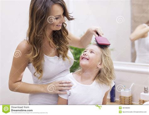 bathroom mother mother and daughter in bathroom stock photo image 48708284