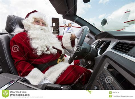 animated santa driving santa driving convertible at airport terminal stock photo image 35613876