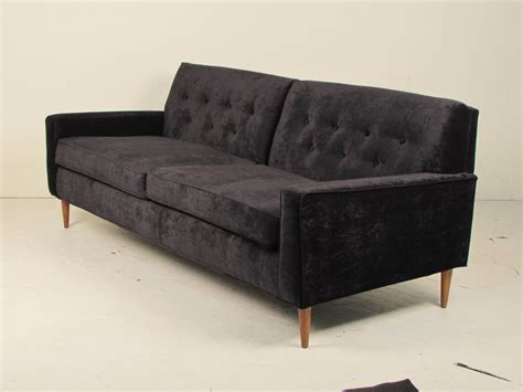 seductive black velvet sofa in the style of milo baughman