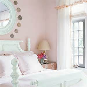 Painted white distressed finish four poster bed with light pink