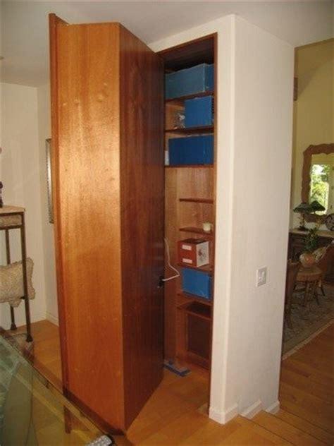 secret wine rack door opens to closet stashvault