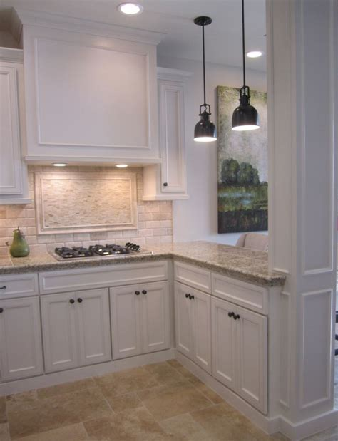white tile backsplash kitchen kitchen with off white cabinets stone backsplash and