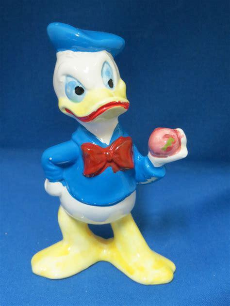 Romper Disney Duck donald duck w apple figurine walt disney productions