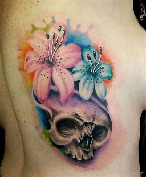 watercolor lily tattoo beautiful watercolor flower and skull on side rib