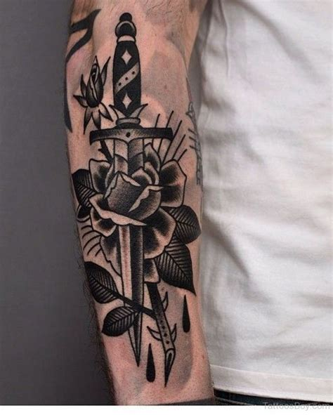 black rose sleeve tattoo black and dagger traditional on arm sleeve