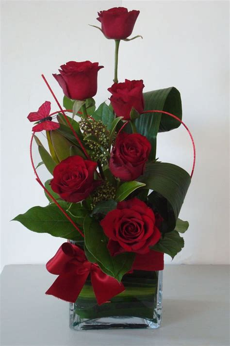 beautiful red roses look close to see the butterfly fresh bloomers flowers and gifts love