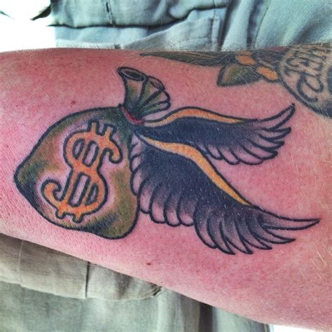 money bag with wings done by steven anderson 920tattoo