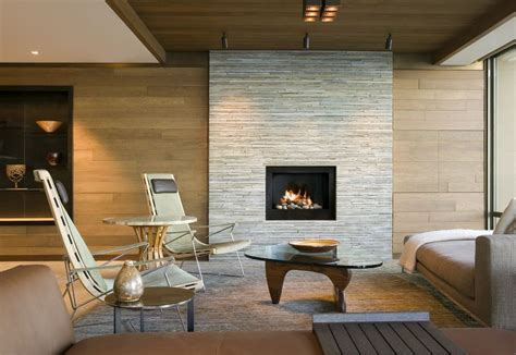 stacked stone fireplace with wood mantle living room