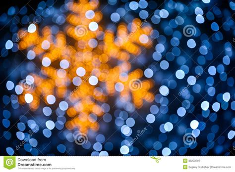 blurred snowflake and lights background royalty free stock