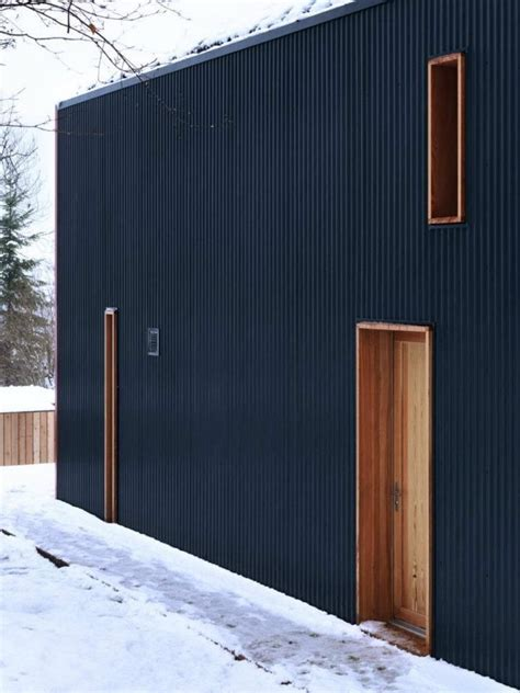 textured front facade modern box home corrugated metal as cladding theblackworkshop ralph