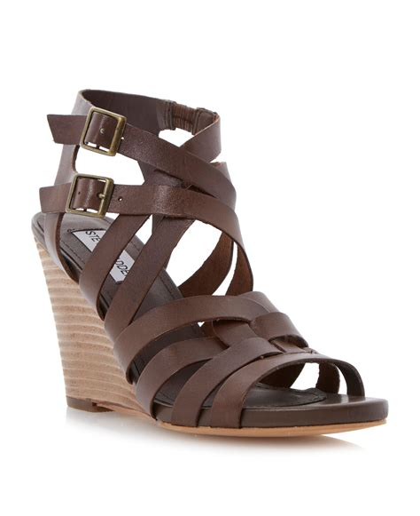 buckle sandals steve madden venis strappy buckle sandals in brown