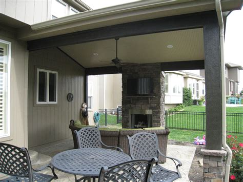 with a roof this olathe patio is simply a whole different