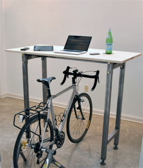 kickstand desk enables cyclists to ride their bikes while