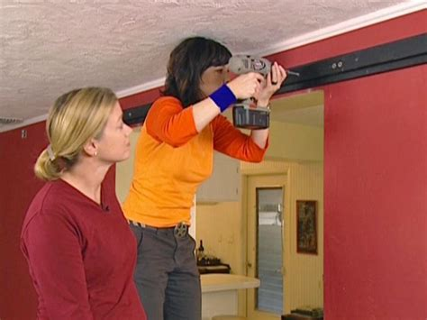 How To Install Barn Door Track How To Hang An Interior Barn Door Track System How Tos Diy