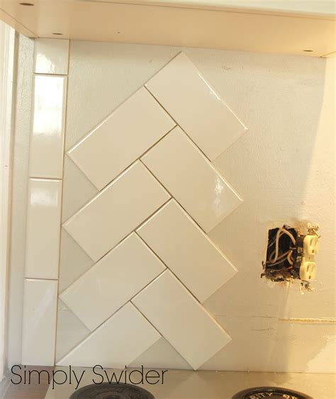 How To Install Backsplash In Kitchen by Subway Tile Back Splash In A Herringbone Pattern Simply