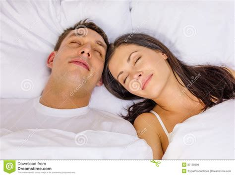 couples in bed images happy couple sleeping in bed royalty free stock images image 37158999