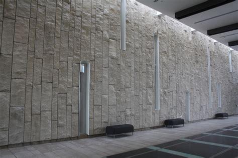 waterloo regional art museum located in kitchener ontario uses sepia adair limestone in a split