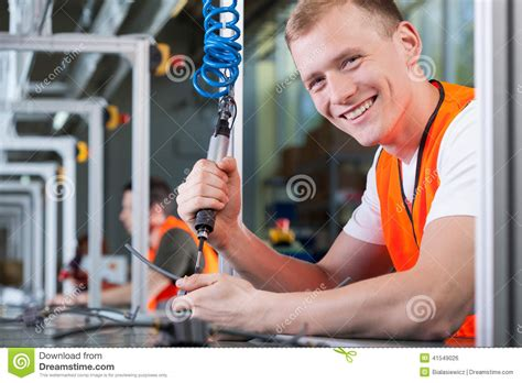 Production Worker by Smiling Working On The Production Line Stock Photo Image 41549026