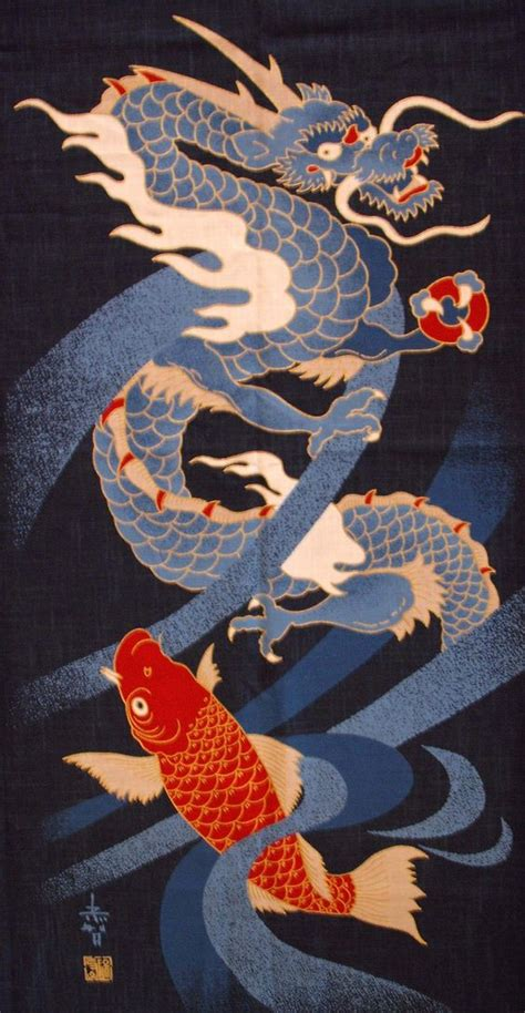 orange koi dragon with blue japanese koi and on