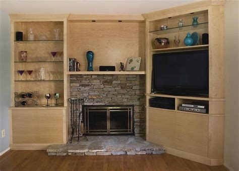 maple media cabinet built around fireplace