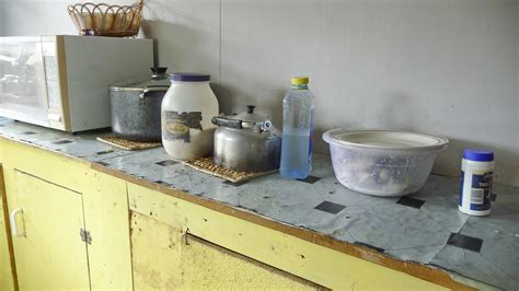 kitchen counter with from left to right large pot with rice sugar teapot and a bowl with