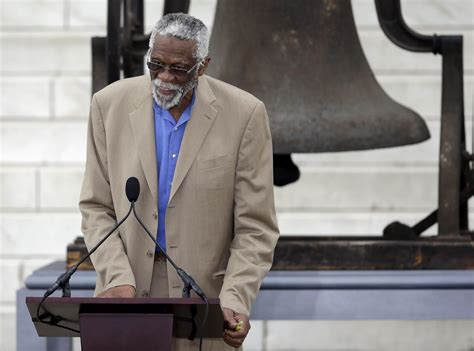 Bill Russell Carrying Gun Airport