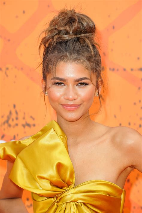 curly hairstyles in a bun Page 2 collections