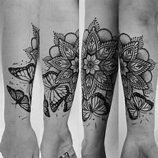 Mandala Oberarm - butterfly mandala henna inspiration