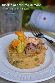 risotto con zucchine e fiori di zucca risotto al profumo di mare con zucchine e fiori di zucca
