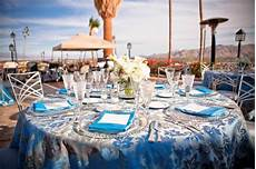 blue silver centerpieces chairs outdoor reception place