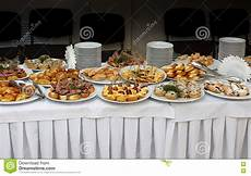 il banchetto catering catering banquet table with baked food snacks sandwiches