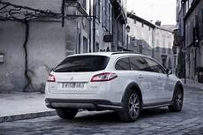 peugeot 508 rxh hybrid4 peugeot confirms uk pricing for 508 rxh crossover and new 508 hybrid4 sedan carscoops