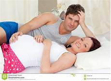 Happy Lying On Bed With Husband Stock