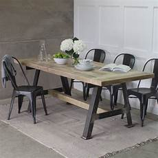 a reclaimed wood dining table with steel a frame by