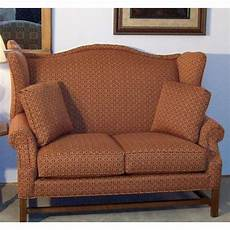 high back settee with arms lancer homespun high wing back settee with rolled arms wayside furniture love seat