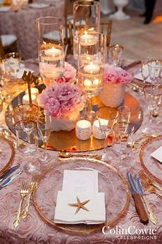 floating candle centerpieces with low flower arrangements