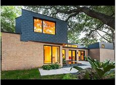 Modern Home Remodel with Exposed Exterior Brick Wall and