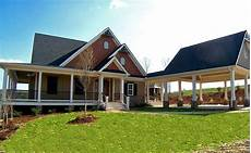 lake house plans with wrap around porch lakefront house plan with wraparound porch and walkout