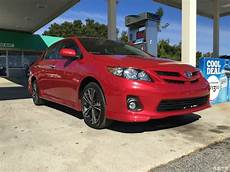 red 2011 corolla with 17inch subaru brz factory wheels